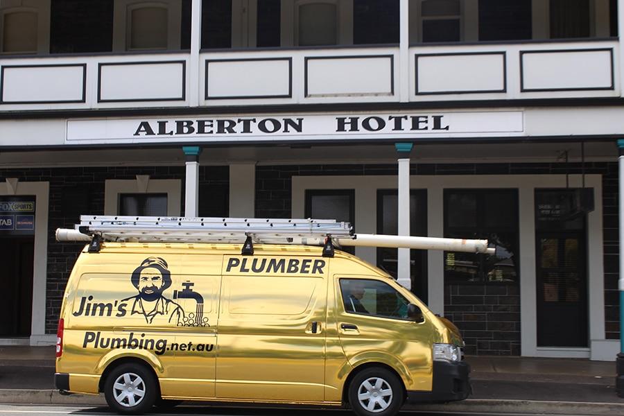 Jims Plumbing Gold Van